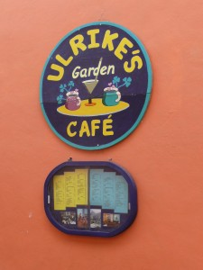Round blue sign of Ulrikes Cafe in Pisac Market, Peru