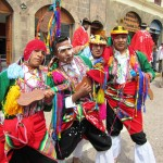 Men dancing in traditional costume in Cusco, Peru