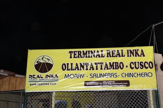 Yellow bus stop sign, Real Inka Colectivo Terminal in Ollantaytambo