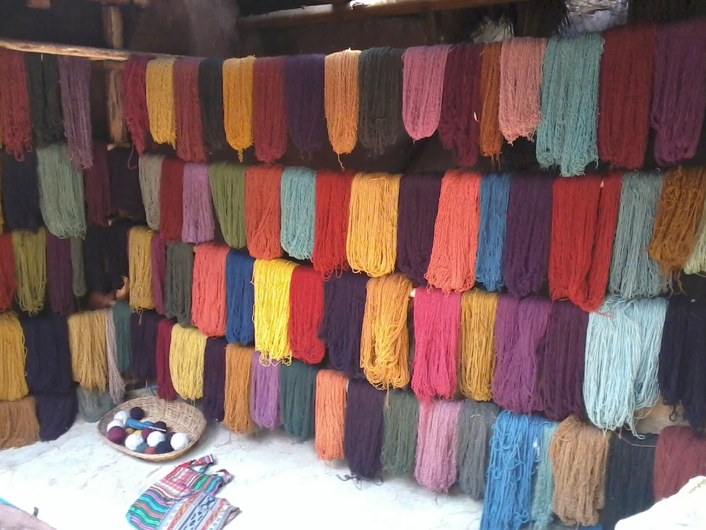 Rack of colorful naturally dyed alapaca wool