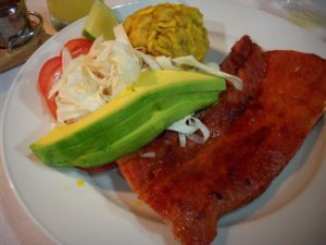 Restaurants In Miraflores - Tacacho dish served on a plate at Amaz