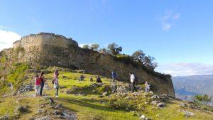 visitors walking around Kuelap city walls