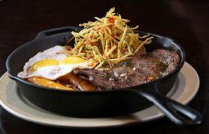Restaurants In Miraflores - Peruvian creole food on a frying pan at Panchita restaurant