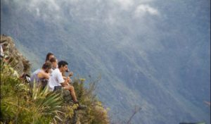 Inca Jungle Trek - Travelers overlooking Urubamba Valley from a cliff