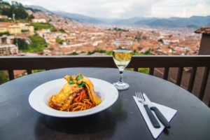 Meal served at a Wild Rover balcony overlooking the city - best hostels cusco