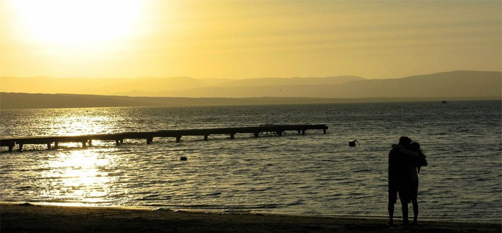 The Paracas sunset casts a golden glow over the Pacific Ocean