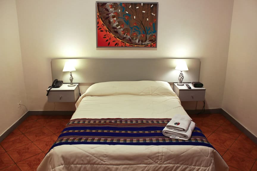 lima hotel - angiolina hotel made-up bed