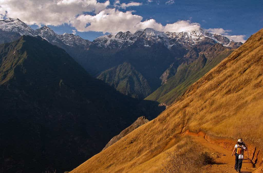 Crisp scrubland transitions to snow capped peaks on the Vilcabamba Traverse Route