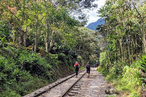 trek along the train tracks to machu picchu